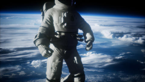 Astronaut in outer space against the backdrop of the planet earth Live Action