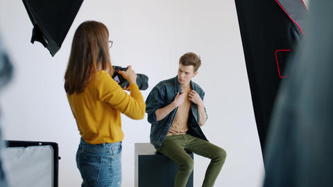 Attractive student fashion model posing for glamour magazine working in photo Live Action