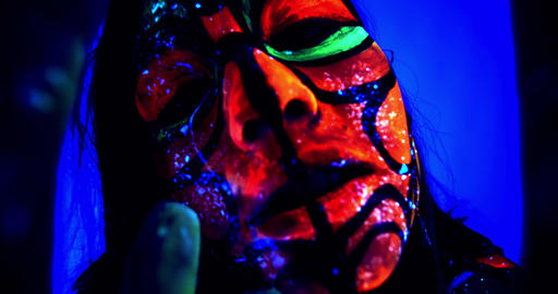 Bright colors and patterns on a womans body, ultraviolet body art, close up, 4k Live Action
