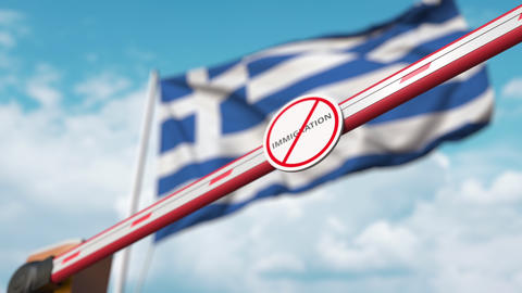 Closed boom gate with no immigration sign on the Greek flag background. Border Live Action