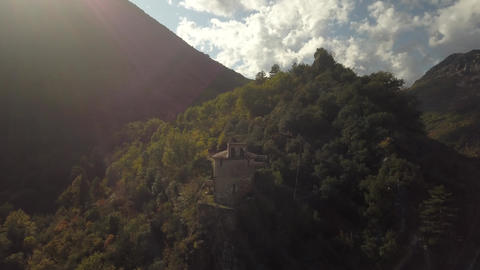 Old historic building on the side of the mountain, surrounded by trees, 4k Live Action