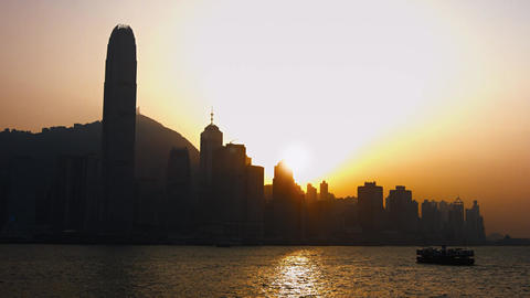 Hong Kong's Skyline and Ferry Boat at Sunset. Video 3840x2160 Footage