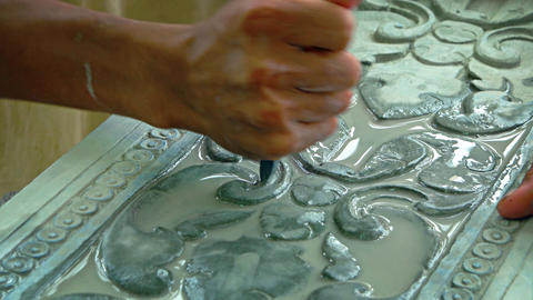 Cambodian Artisan Carving on a Stone Slab in a Workshop. Video UltraHD Live Action