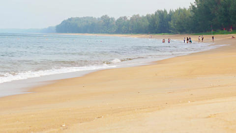 Tourists Enjoying a Beach Day in Phuket. Thailand. Video 4k Filmmaterial