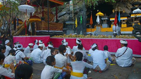 Parishioner and worshipers in white clothes near sacred cave Footage