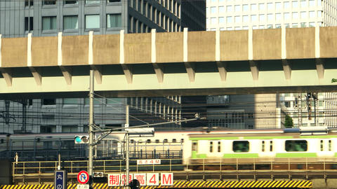 Tokyo - May 2016: Close up of trains passing by. 4K resolution Footage