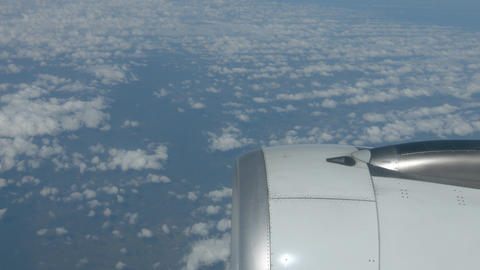 Airborne Perspective of Altocumulus Clouds taken over Engine of Airliner Footage