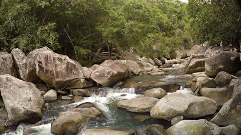 Water Tumbles along a Rocky River Bed in Vietnam. with Sound Footage