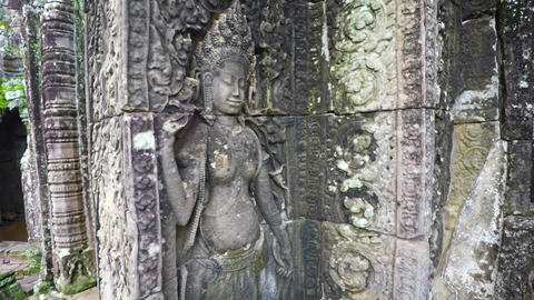 Detailed designs of religious bas relief sculpture on an ancient stone wall Footage