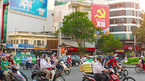 Typical traffic at an urban intersection in Ho Chi Minh City. with sound Footage