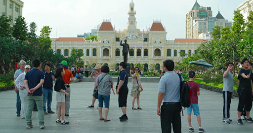 Tourists enjoying a local park in front of the city hall in Ho Chi Minh City Footage