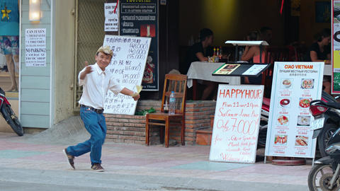 Restaurant greeter dances as he invites customers to dine in Nha Trang Live Action