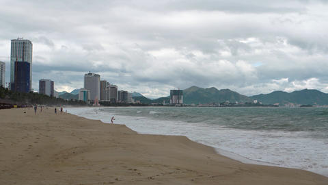 Beautiful beach in Nha Trang. with highrise buildings in the background Footage
