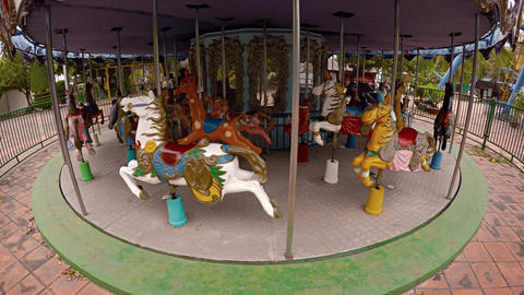 Non-functioning carousel at a closed amusement park in Nha Trang Footage