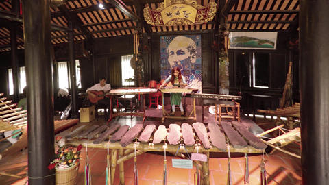 Local musicians at a cultural center in Nha Trang. with sound Footage