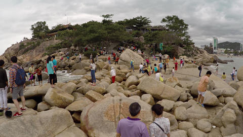 Tourists climbing over the Hon Chong Rocks. a popular attraction in Nha Trang Footage