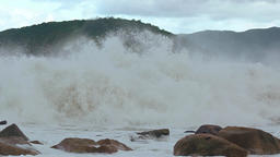 Breakers Crash over a Rocky Beach on a Cloudy Day. UltraHD video Footage