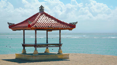 Balinese Pagoda Stands against a Tropical Sea Background Footage