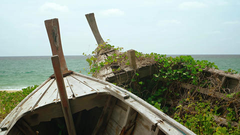 Wooden Boats. Abandoned and Rotting on a Beach in Thailand Live Action