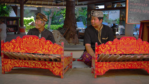 Local musicians perform traditional Balinese music in a restaurant in Bali Footage