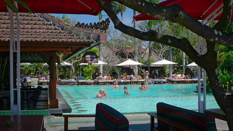 Tourists enjoying the pool at a luxury resort hotel in Sanur. Bali. Indonesia Footage