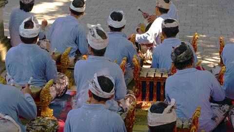 Group of local musicians in costume. playing Balinese musical instruments Footage