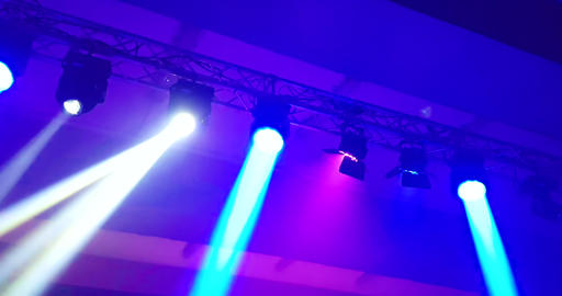 abstract blue and violet purple, bright shiny stage lights flashing movement entertainment spotlight Live Action