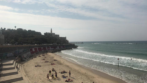 Tel Aviv, Israel - October 22, 2019: tourists relax on the beach part 5 Live Action