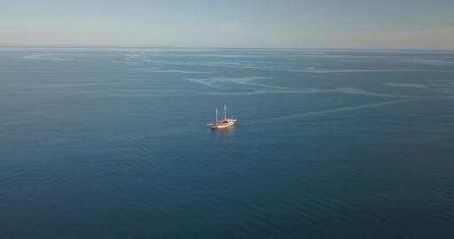 Beautiful boat is sailing in the sea, Mediterranean Sea with a view on the shore Live Action