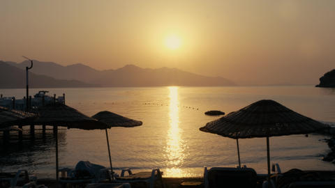 Evening sea sunset landscape. Golden sun reflecting on sea water surface Live Action