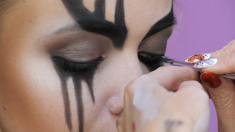 Easy Halloween Makeup. Eyelash extension black. Gluing the hair to the eyelashes Live Action