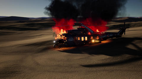 burned military helicopter in the desert at sunset Live Action