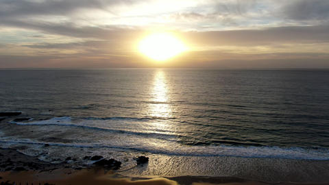 Aerial view of Pacific ocean colorful sunset with sun reflection on the ocean Live Action