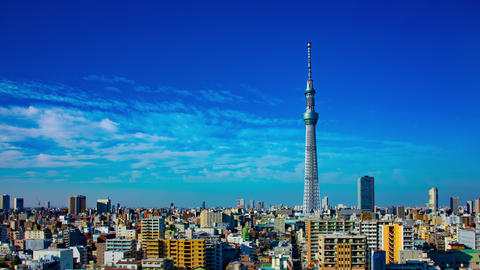 A timelapse near Tokyo sky tree at the urban city in Tokyo wide shot panning Live Action