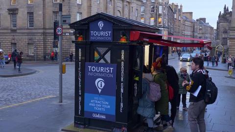 Tourist Information desk in Edinburgh - EDINBURGH, SCOTLAND - JANUARY 10, 2020 Live Action