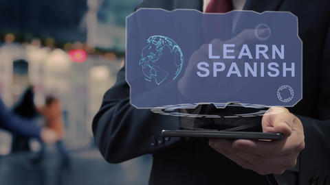 Businessman uses hologram Learn Spanish Live Action