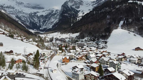 Well-known winter sports area Engelberg-Titlis in the Alps - drone flight Live Action