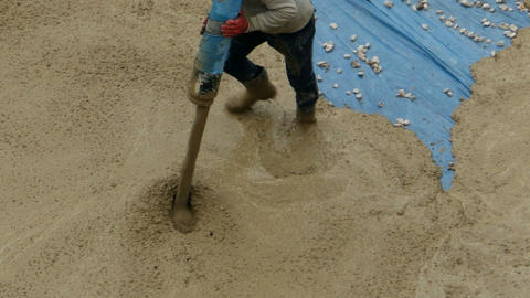 builder directs pipe with pouring concrete Live Action
