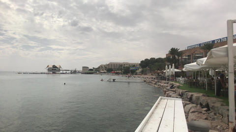 Eilat, Israel - October 24, 2019: Tourists bathe in the sea part 3 Live Action