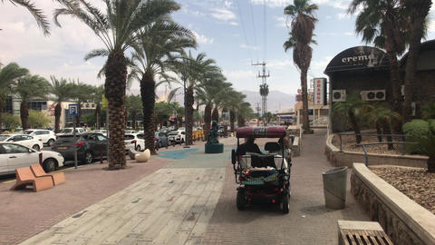 Eilat, Israel - transport moves through the streets of the resort town part 6 Live Action