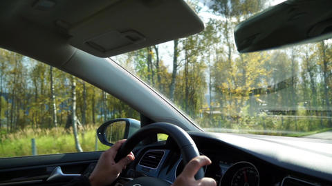 Driving a car on beautiful scenic asphalt Norway road in sunny autumn weather Live Action