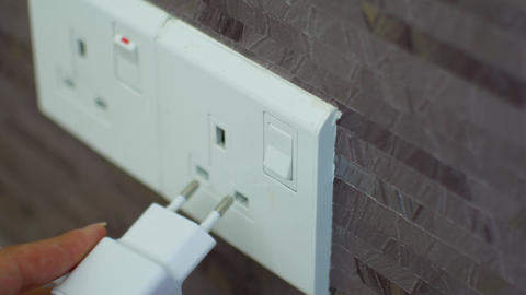 Connecting the charger to a foreign outlet through an adapter Live Action