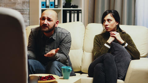 Unhappy young woman with husband at couple therapy Live Action