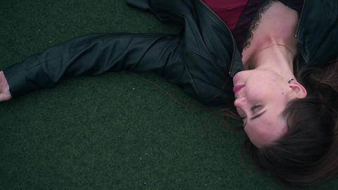 A beautiful and passionate girl lies on the floor of a court. A young woman is Live Action