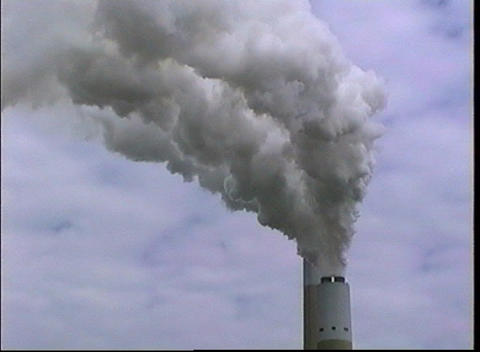 Smoke pours out the top of an industrial smokestack Footage