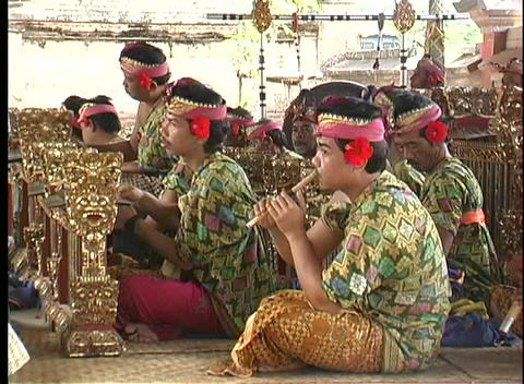 Balinese men playing instruments in an orchestra use a... Stock Video Footage