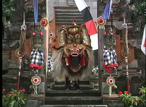 A Balinese dancer performs on the steps of a city in... Stock Video Footage