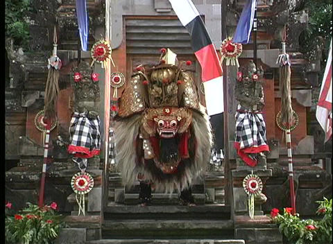 A Balinese dancer performs on the steps of a city in Indonesia Footage