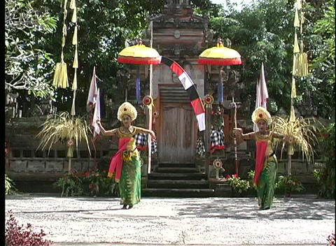 Pan-shot of two graceful Balinese dancing women Footage