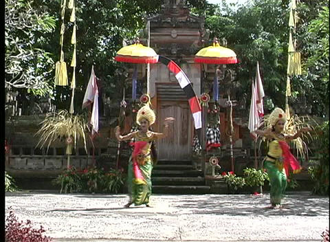 Pan-shot of two graceful Balinese dancing women Stock Video Footage